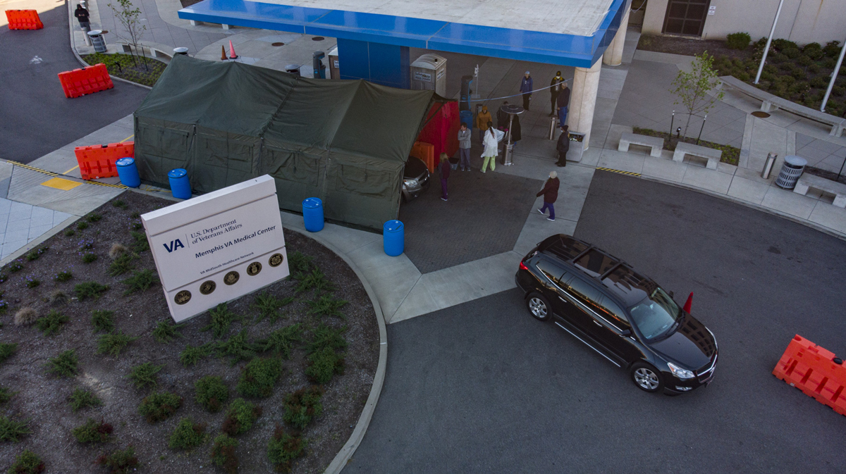 This drive-through lab can handle two cars at a time, as blood tests are taken in the tent.